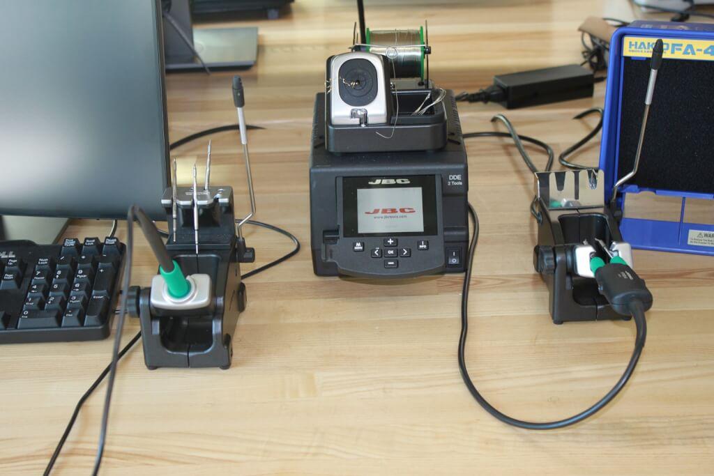 Large scale soldering setup at workstation.