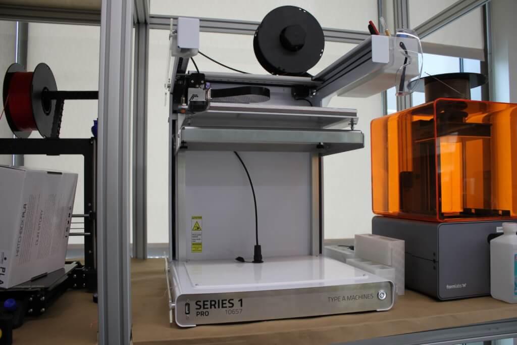 3D printer on a shelf.