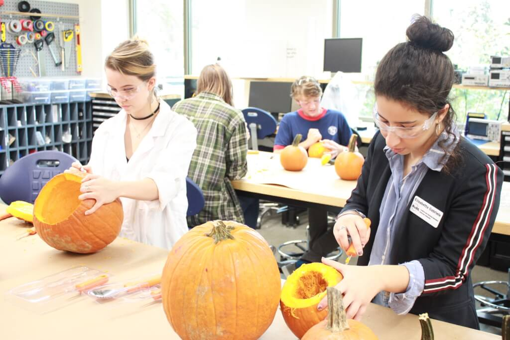 Students working on pumpkin designs