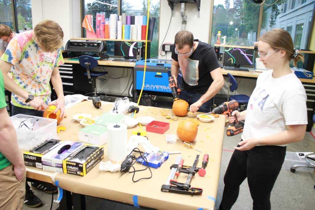 Group of students working on their pumpkins