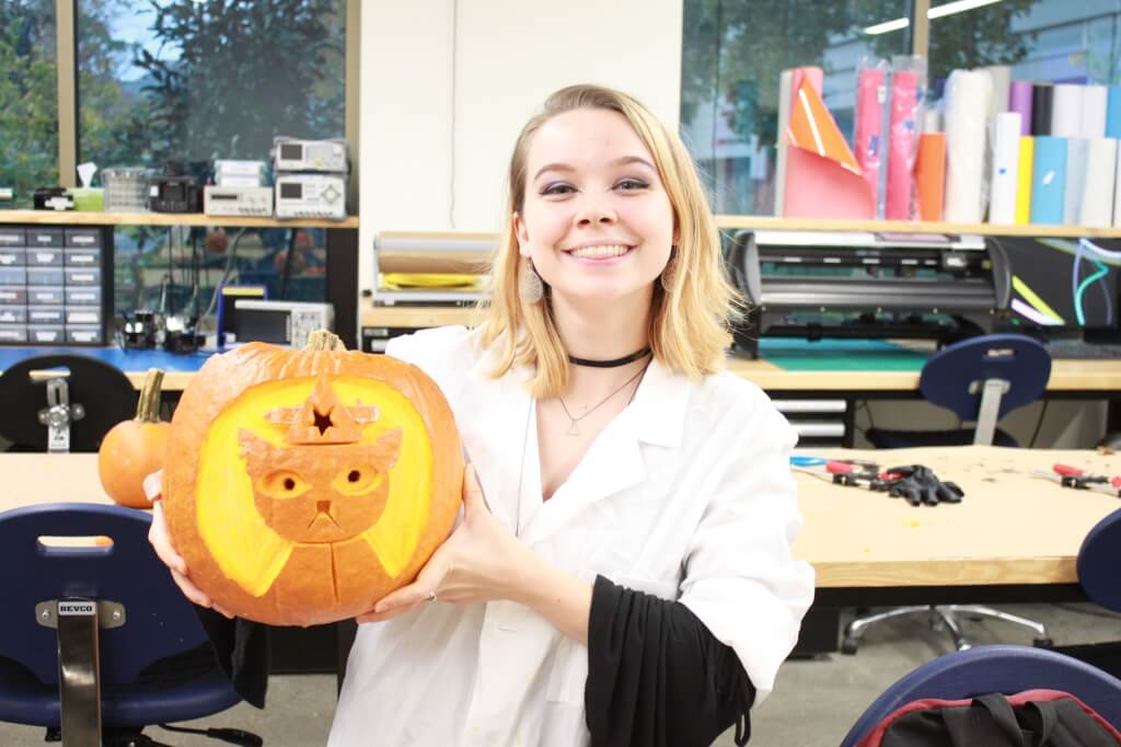 Student holding finished carved pumpking
