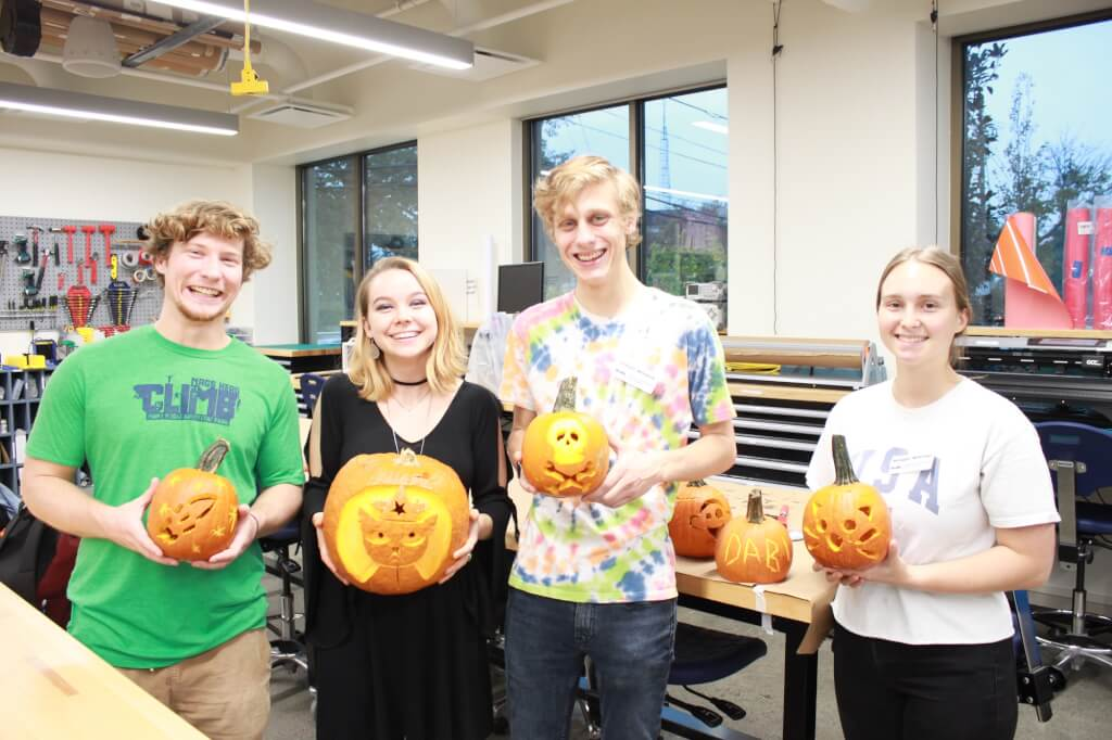 Students with carved pumpkins