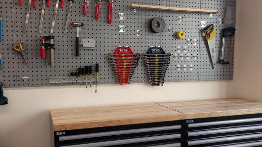Tool rack on lab wall.