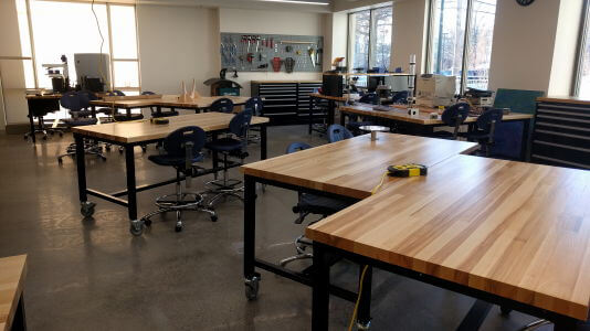 Worktables in lab setting.